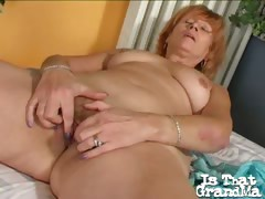 Trashy blonde granny Lady spreading and fingering her hairy