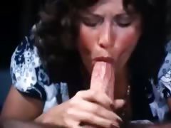 70s porn brunette gives deep blow job to a doctor