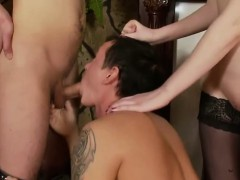 Horny femdom uses two slaves for her pussy