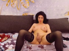 Busty shemale strokes her dick so hard till she almost